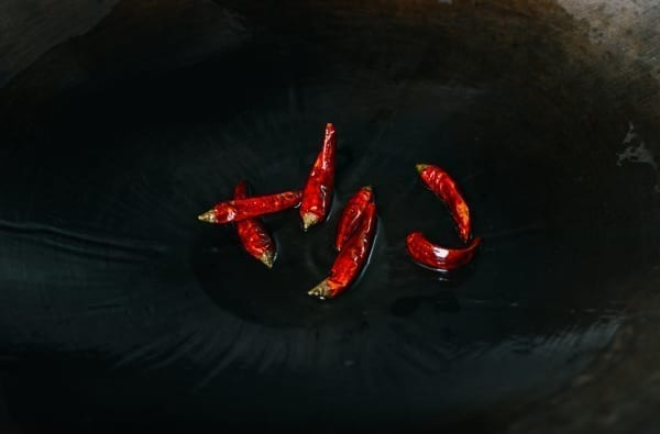 Dried chili peppers in wok, thewoksoflife.com
