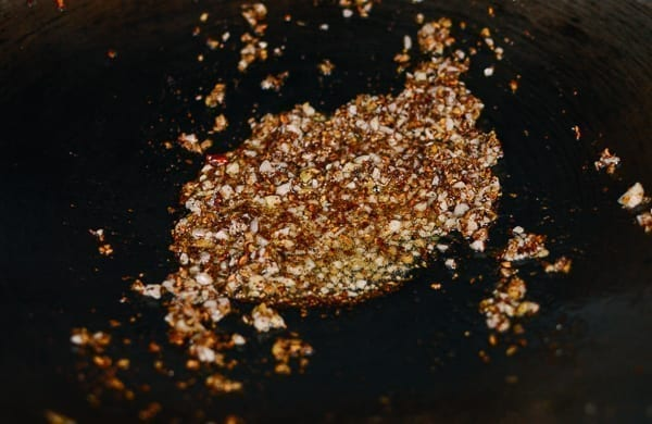 Frying sichuan peppercorns, ginger, and garlic, thewoksoflife.com