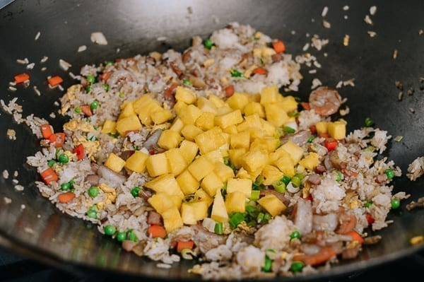 Adding pineapple to fried rice, thewoksoflife.com