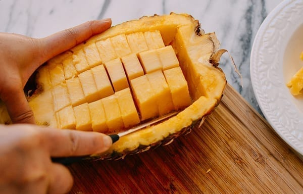Removing pineapple chunks, thewoksoflife.com