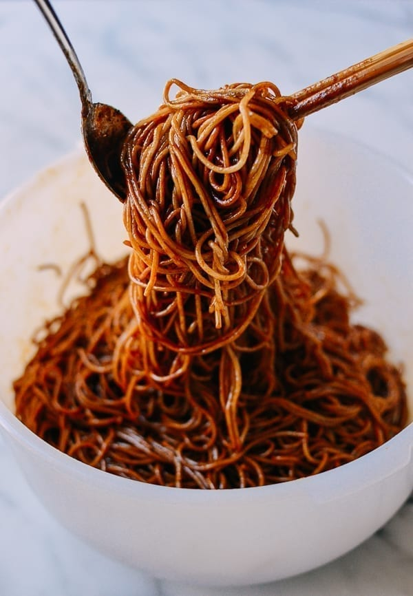Tossing noodles with sauce, thewoksoflife.com