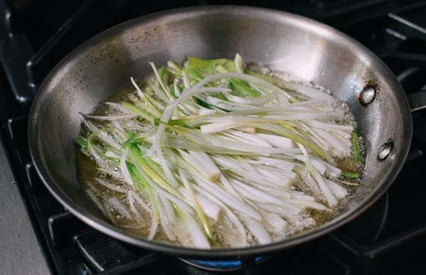 Frying scallions in oil, thewoksoflife.com