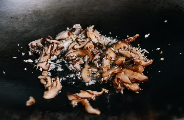 Garlic and shiitake mushrooms in wok, thewoksoflife.com