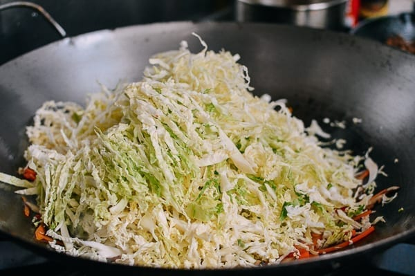 Adding cabbage to filling, thewoksoflife.com