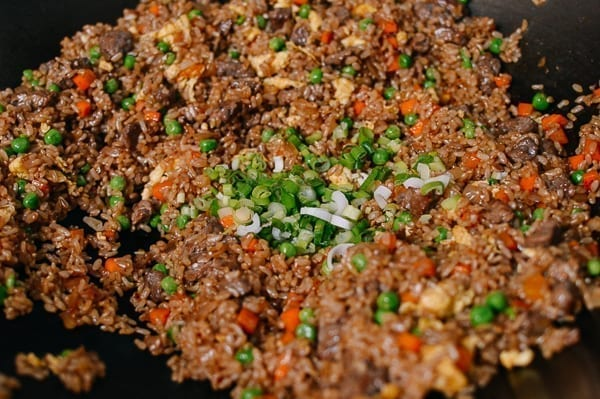 Adding scallions to fried rice at the end, thewoksoflife.com