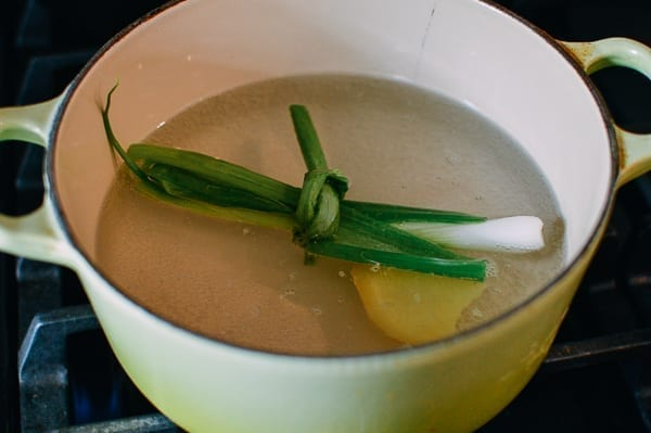 Water with ginger and scallion for poaching, thewoksoflife.com