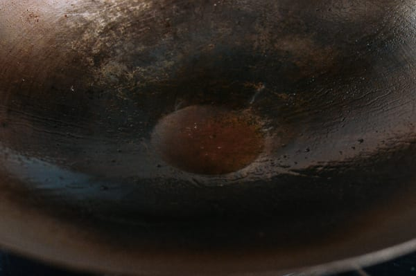 Oil left in the woks, thewoksoflife.com