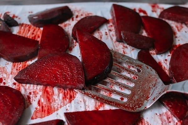 Flipping Beets on Baking Tray, thewoksoflife.com