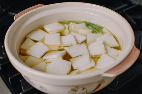 Adding winter melon to soup, thewoksoflife.com