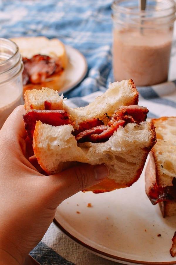 Bite taken out of bacon sandwich, thewoksoflife.com