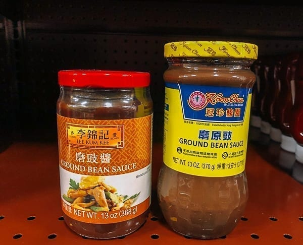 Ground Bean Sauce products on shelves, thewoksoflife.com