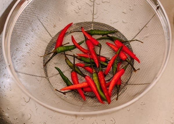 Chilies in colander, thewoksoflife.com