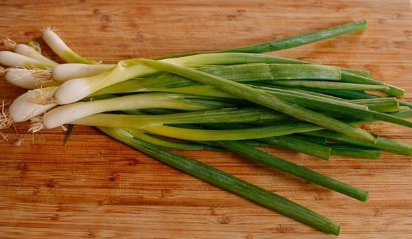Scallions on cutting board, thewoksoflife.com