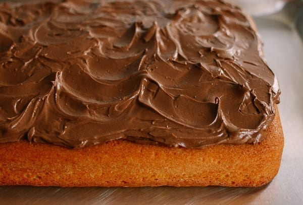 Yellow cake with chocolate frosting, thewoksoflife.com