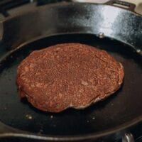 Cooking buckwheat pancakes in cast iron skillet, thewoksoflife.com