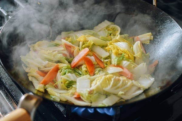 Napa cabbage leaves cooked until wilted, thewoksoflife.com