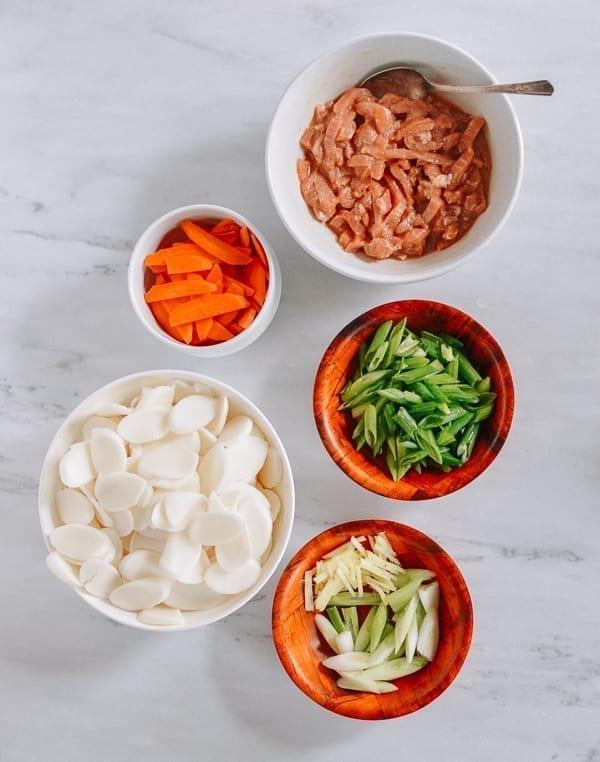 Rice cakes, carrots, scallions, ginger, and marinated pork, thewoksoflife.com
