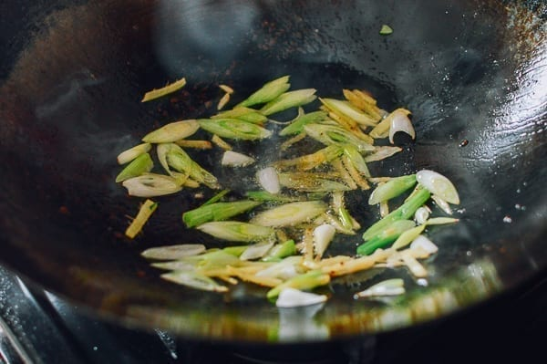 Ginger and scallions cooking in wok, thewoksoflife.com