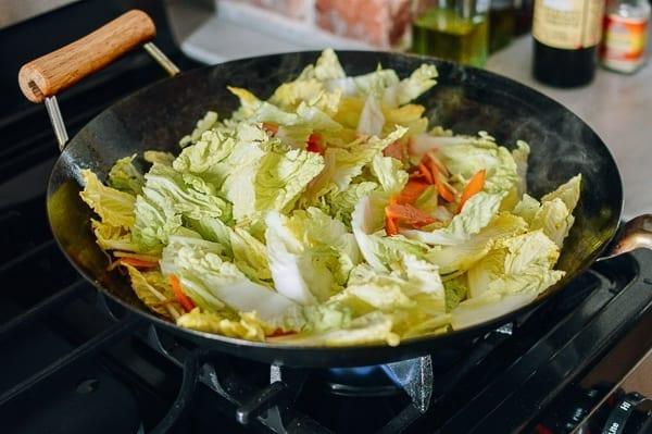 Stirring in napa cabbage, thewoksoflife.com