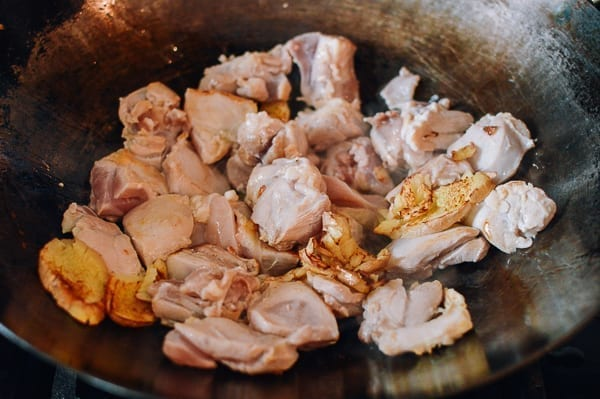 Searing chicken with ginger in a wok, thewoksoflife.com