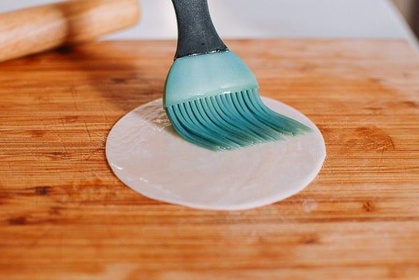 Brushing oil on dumpling wrapper, thewoksoflife.com