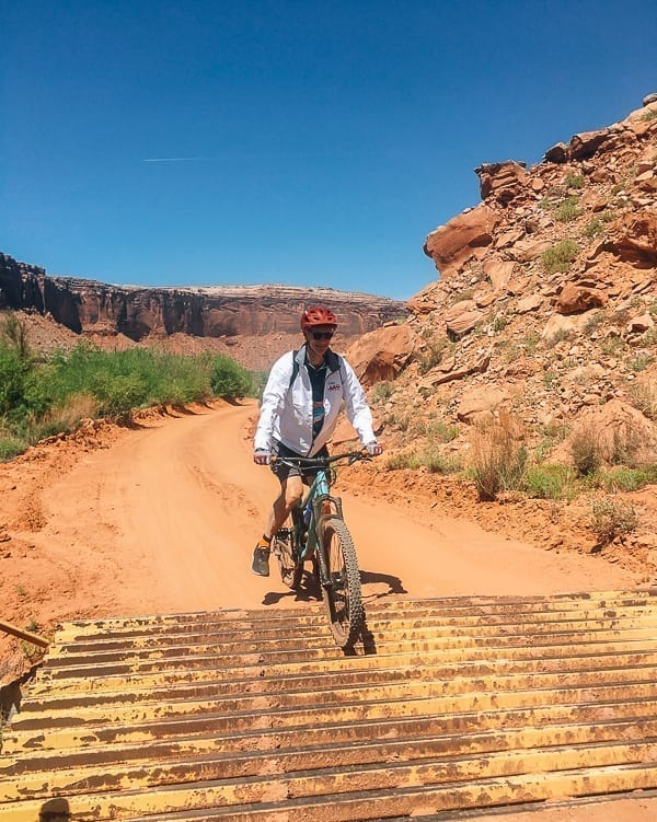 Lee - Mountain biking Moab over cattle grate by thewoksoflife.com