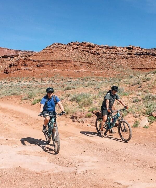 Bill and friend biking in Moab, Utah - thewoksoflife.com