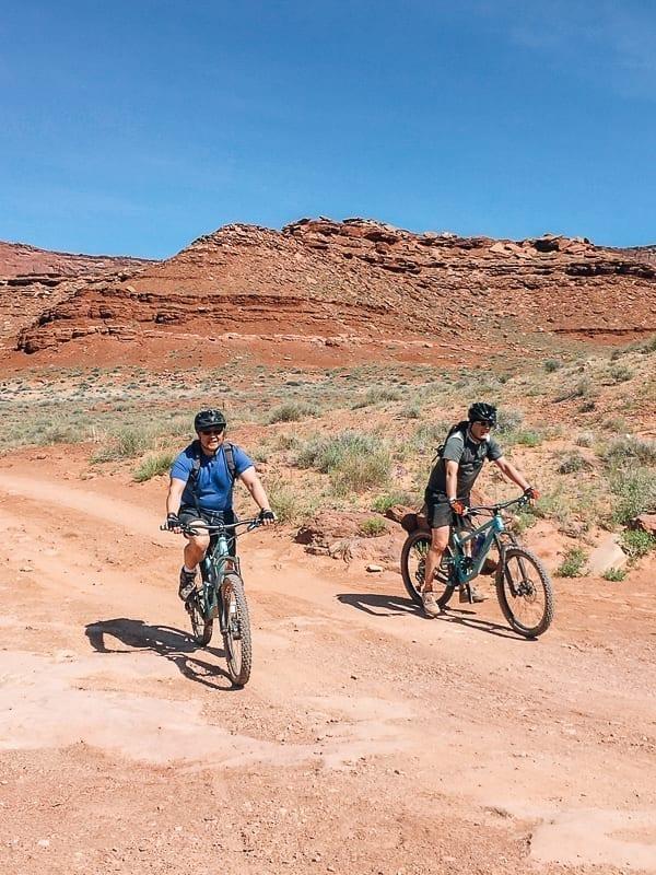 Bill and friend biking in Moab, Utah - thewoksoflife.com
