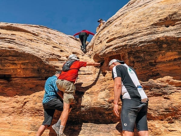 Climbing out of Holeman Slot canyon - Canyonlands National Park by thewoksoflife.com