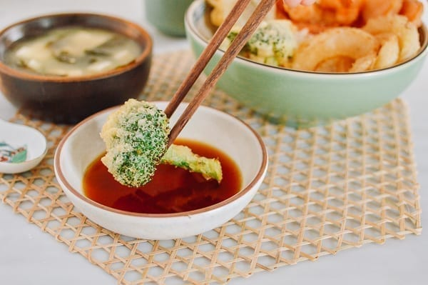 Dipping broccoli tempura into sauce, thewoksoflife.com