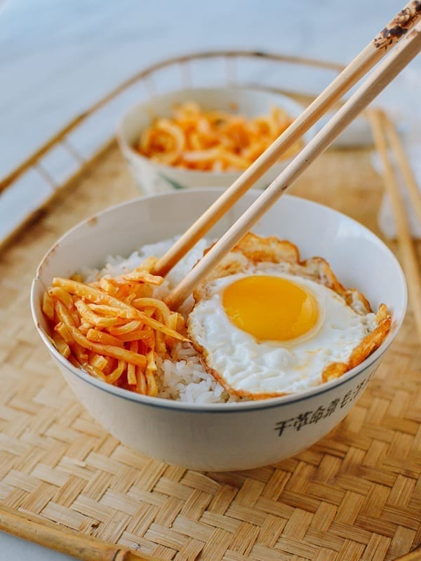 Chili bamboo shoots over rice with an egg, thewoksoflife.com