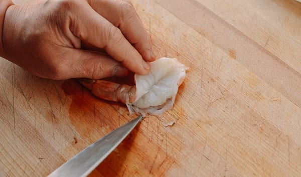 Opening up butterflied shrimp