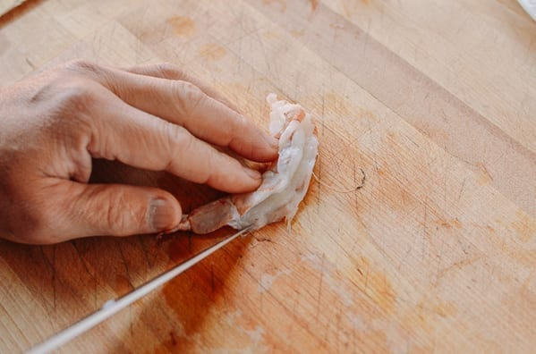 Butterflying shrimp from the back and de-veining it
