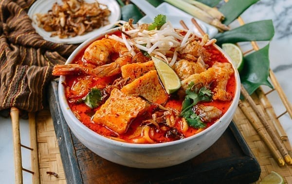 Bowl of spicy curry laksa, thewoksoflife.com