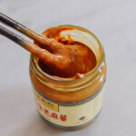 Stirring jar of Chinese sesame paste, thewoksoflife.com