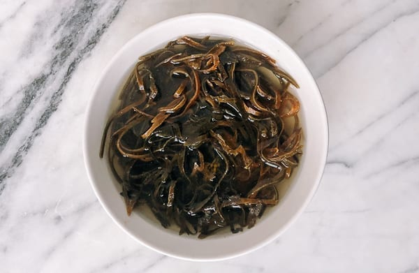 Rehydrated Dried kelp strips in a bowl by thewoksoflife.com
