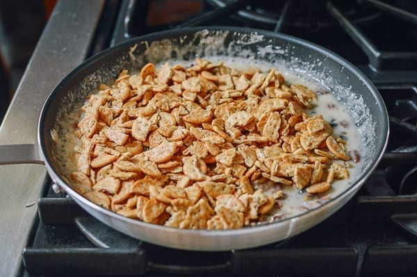 Adding crackers to marshmallow mixture, thewoksoflife.com