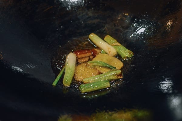 Ginger, scallions, and rock sugar cooking in wok with oil, thewoksoflife.com