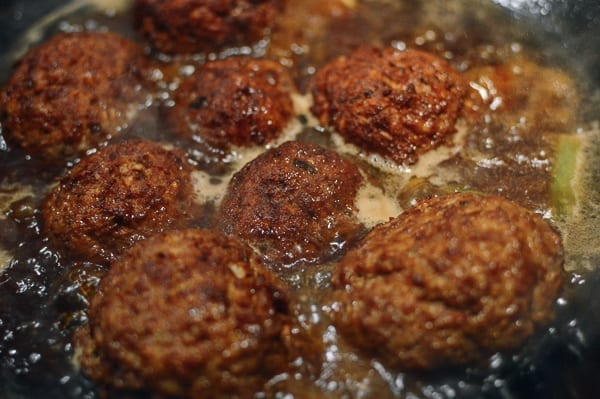 Braising lion's head meatballs in sauce, thewoksoflife.com