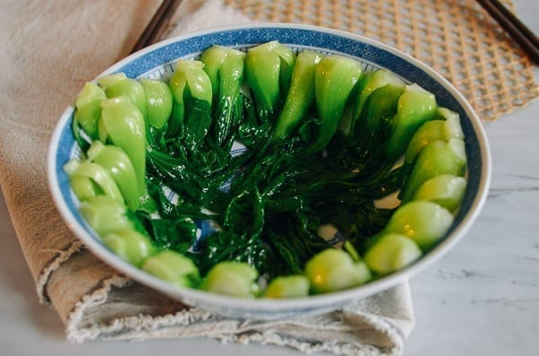 Blanched baby bok choy in serving bowl, thewoksoflife.com