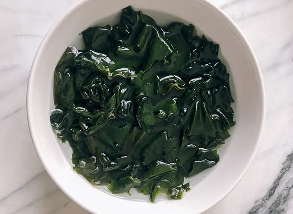rehydrated wakame seaweed in a bowl by thewoksoflife.com