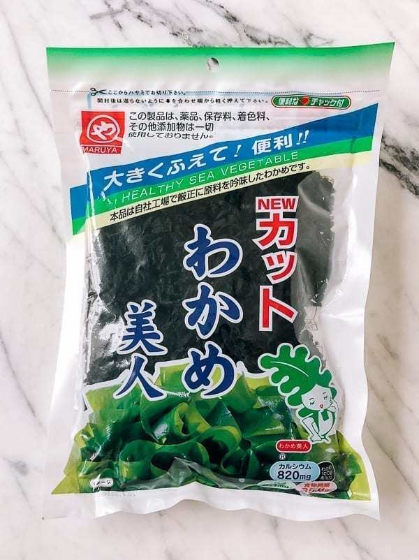 dried wakame seaweed in a package by thewoksoflife.com