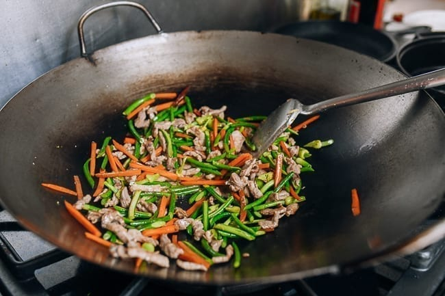 Stir-frying garlic scapes with pork