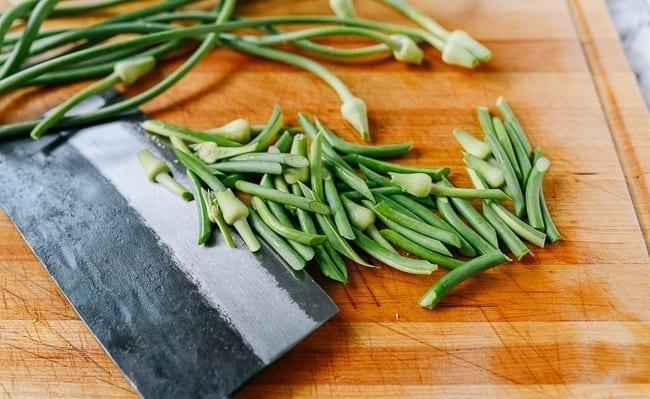 Cutting garlic scapes
