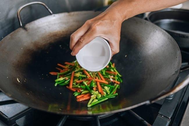 Adding cornstarch slurry to stir-fry
