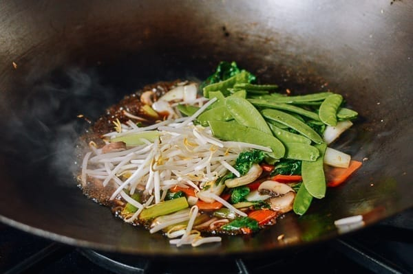 Adding bean sprouts and snow peas, thewoksoflife.com