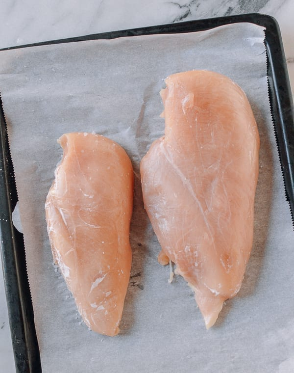 Partially frozen chicken breasts, thewoksoflife.com