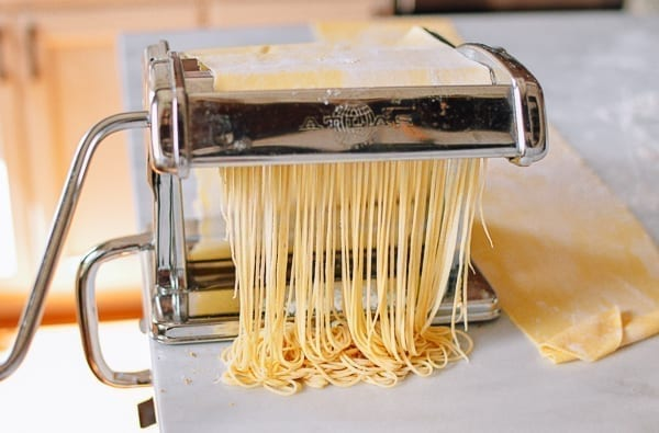 Cutting thin noodles with pasta roller, thewoksoflife.com