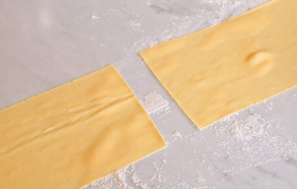 Cutting dough in half, thewoksoflife.com