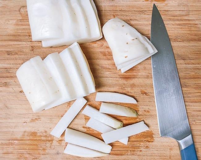 Cutting daikon radish into pieces, thewoksoflife.com